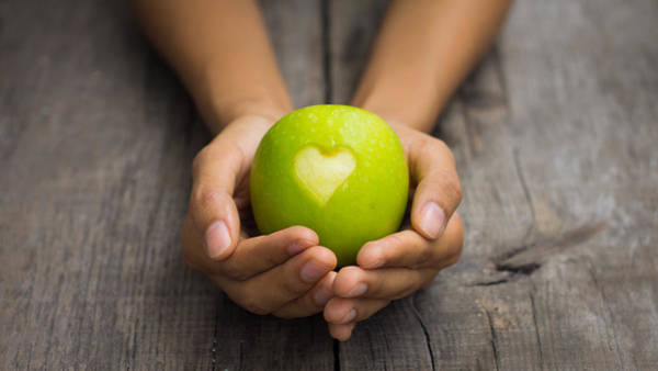Wall Art - Photograph - Green Apple With Engraved Heart by Aged Pixel