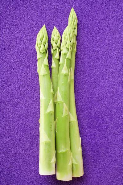 Vegies Photograph - Green Asparagus Spears On Blue Background by Foodcollection