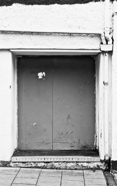 Drainage Photograph - Grey Door by Tom Gowanlock