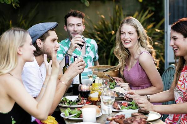 Wall Art - Photograph - Group Of Friends Eating Lunch Outdoors by Science Photo Library