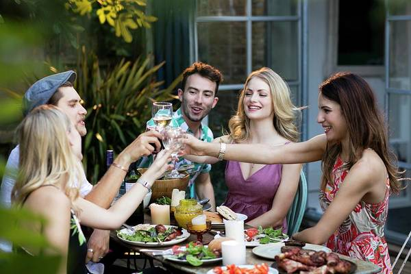 Wall Art - Photograph - Group Of Friends Toasting by Science Photo Library