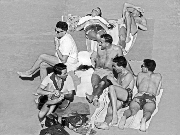 Sunbather Photograph - Group Of Men Sunbathing by Underwood Archives