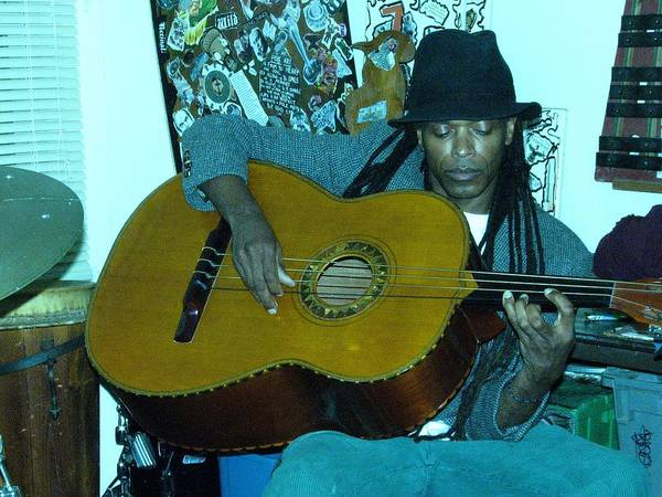 Photograph - Gully Guitar And Black Hat  by Cleaster Cotton