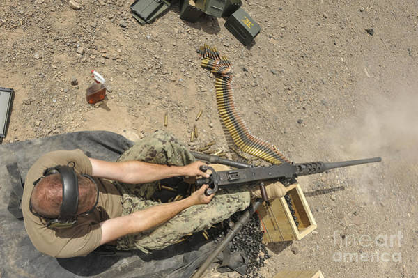 Mounted Shooting Photograph - Gunners Mate Fires An M2 .50-caliber by Stocktrek Images