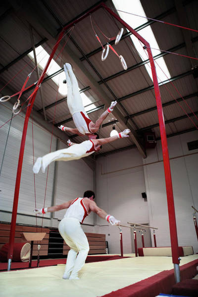Agile Photograph - Gymnast Performing On Rings by Gustoimages/science Photo Library