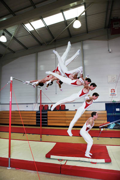 Agile Photograph - Gymnast Swinging by Gustoimages/science Photo Library
