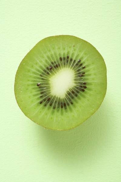 Kiwifruit Photograph - Half A Kiwi Fruit (overhead View) by Foodcollection