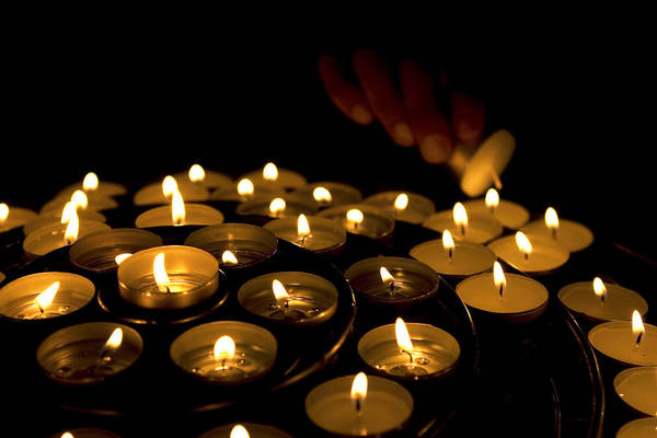 Photograph - Hand Lighting Candles by Fabrizio Troiani