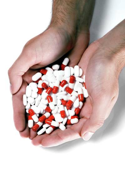 Wall Art - Photograph - Handful Of Pills by Coneyl Jay/science Photo Library