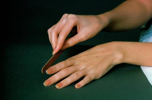 Body Part Photograph - Hands Of A Model  Using An Emery Board by William Connors