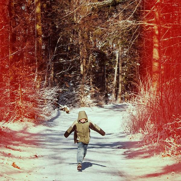 Run Wall Art - Photograph - Happy Young Boy Running In The Winterly Forest by Matthias Hauser