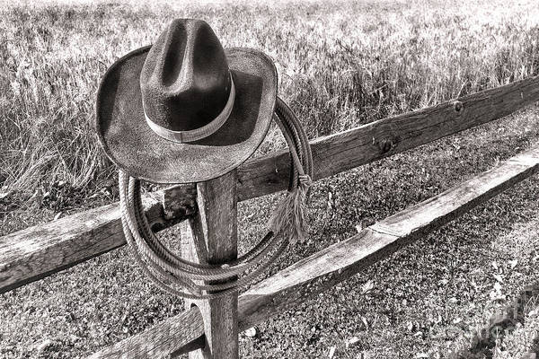 Fence Post Photograph - Hat And Lariat by Olivier Le Queinec