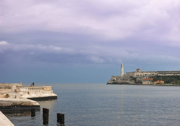 Havana Malecon With Morro Lighthouse And A Lonely, Unrecognizable Person Relaxing By The Sea, Cuba Art Print by Smartshots International
