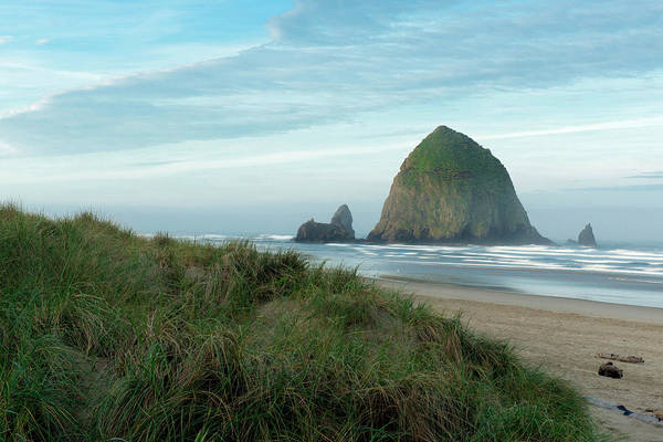 Oregon Dunes Photograph - Hay Stack Rock On The Sandy Beach by Greg Probst