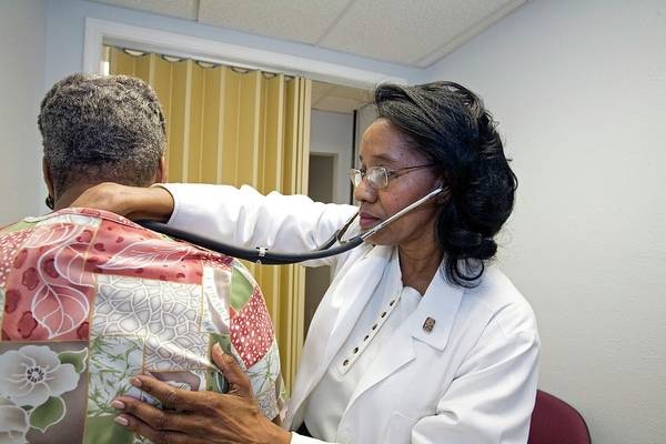 Lower Ninth Ward Photograph - Healthcare Clinic Examination by Jim West