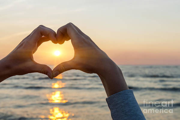 Wall Art - Photograph - Heart Shaped Hands Framing Ocean Sunset by Elena Elisseeva