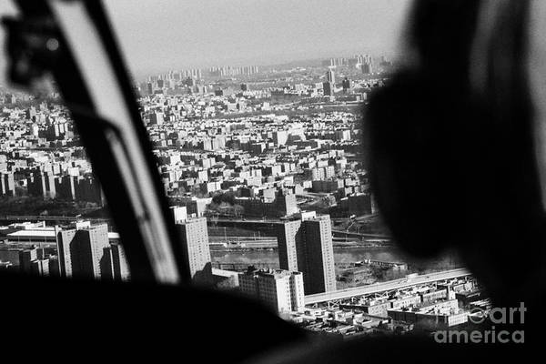 Copter Photograph - Helicopter Flies Over Harlem And East River New York City by Joe Fox