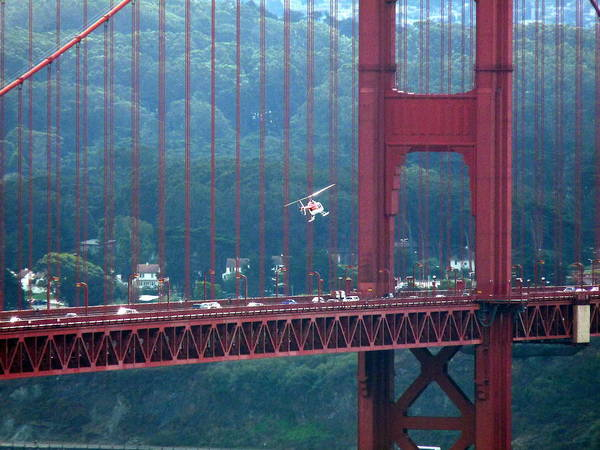 Photograph - Helicopter In Golden Gate Bridge by Jeff Lowe