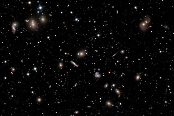 Interacting Galaxies Wall Art - Photograph - Hercules Galaxy Cluster (abell 2151) by Russell Croman/science Photo Library