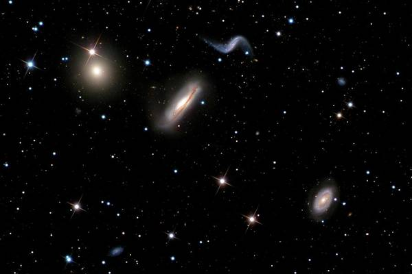 Interacting Galaxies Wall Art - Photograph - Hickson Compact Group 44 Galaxy Cluster by Russell Croman/science Photo Library