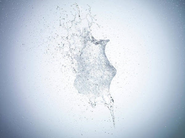 Motion Photograph - High Speed Image Of Water Exploding by Level1studio