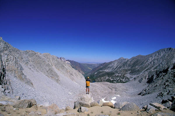 Wall Art - Photograph - Hiker Looking Over A Boulder Filled by Corey Rich