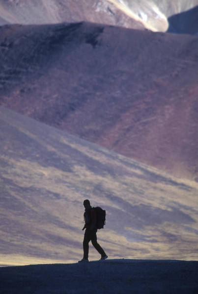 Wall Art - Photograph - Hiker Silhouette In Mountain by Peter McBride