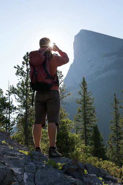 Wall Art - Photograph - Hiker Takes Picture With Smartphone by Philip & Karen Smith / TFA