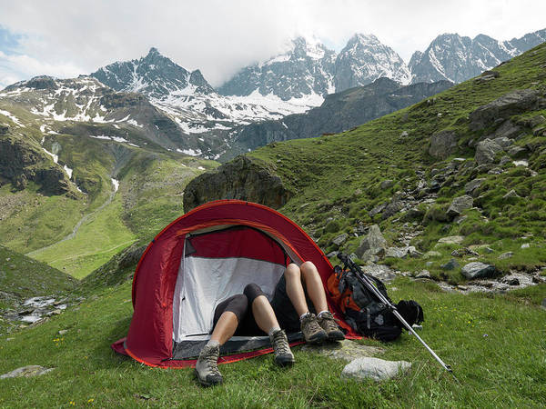 Wall Art - Photograph - Hikers Legs Protrude From Tent by Philip & Karen Smith / TFA
