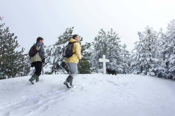 Wall Art - Photograph - Hikers On A Mountain Top With A Cross by Marko Radovanovic