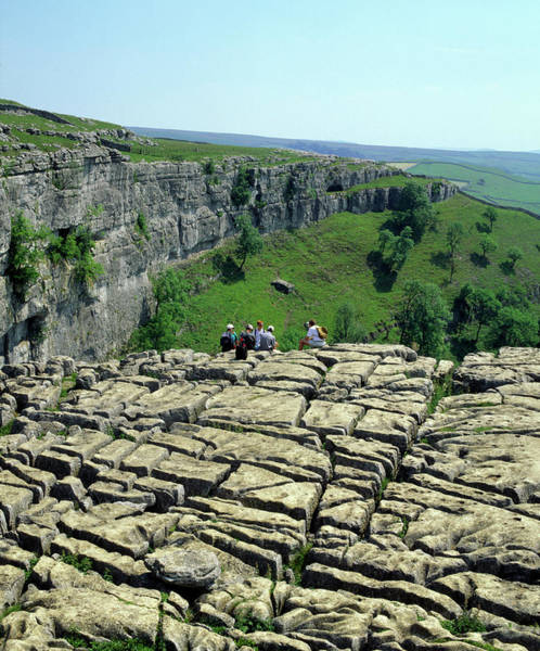 Weathering Photograph - Hikers On Limestone Pavement by Martin Bond/science Photo Library