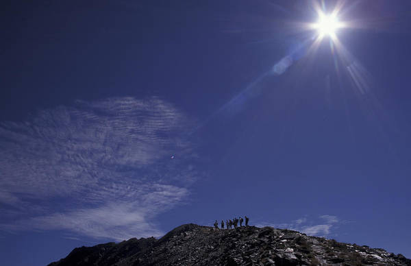 Bugaboo Photograph - Hikers On Ridge In Mountains by Chris Pinchbeck