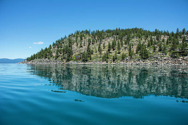 Lake Tahoe Photograph - Hillside Reflected On Glassy Water by Chasethesonphotography