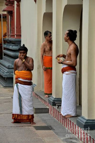 Photograph - Hindu Priests Relax After Morning Rituals Singapore by Imran Ahmed