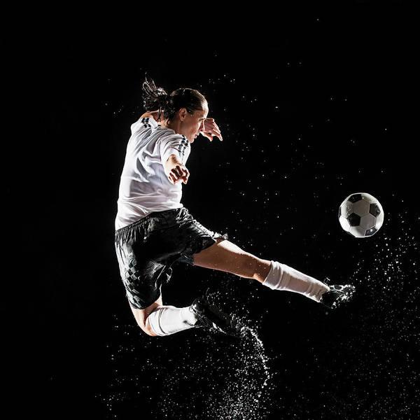 Photograph - Hispanic Soccer Player Splashing In by Erik Isakson
