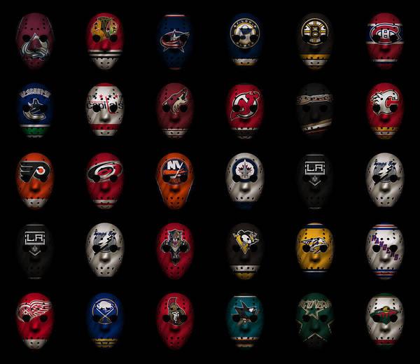 Wall Art - Photograph - Hockey Jersey Goalie Masks by Joe Hamilton