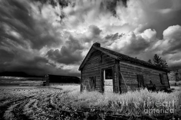 Homestead Under Stormy Sky Art Print