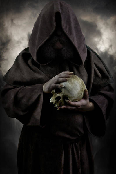 Photograph - Hooded Moustached Man Wearing Dark Cloak And Holding A Human Skull In His Hands by Jaroslaw Blaminsky