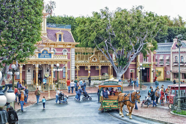 Clothier Photograph - Horse And Trolley Turning Main Street Disneyland 01 by Thomas Woolworth