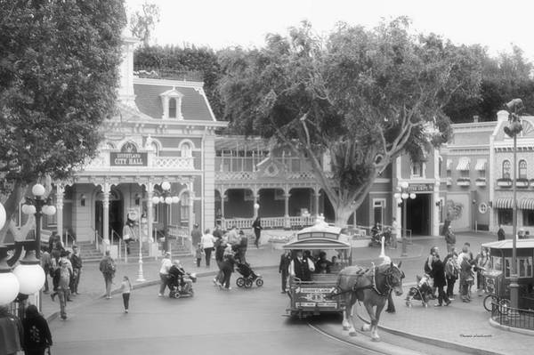 Clothier Photograph - Horse And Trolley Turning Main Street Disneyland Bw by Thomas Woolworth