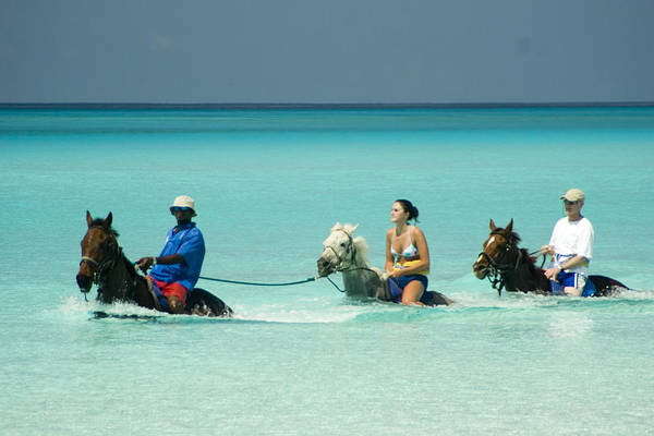 Horseback Photograph - Horse Riders In The Surf by David Smith