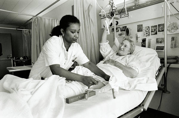 Traction Photograph - Hospital Nurse And Patient by Henny Allis/science Photo Library
