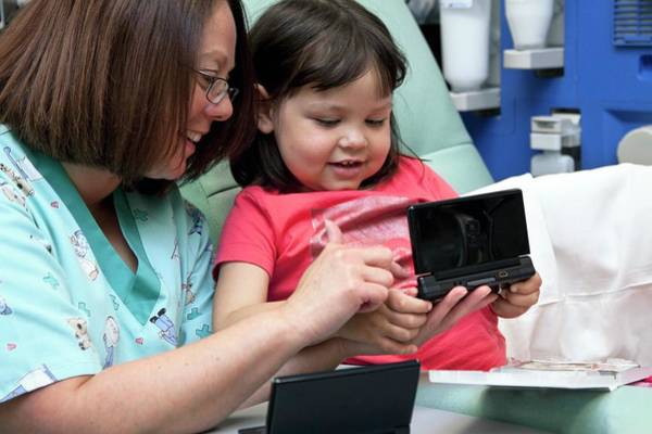 Wall Art - Photograph - Hospital Play Specialist by Life In View/science Photo Library