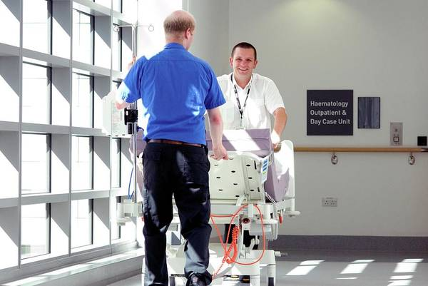 Porter Photograph - Hospital Porters by Lth Nhs Trust/science Photo Library