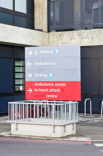 Red Arrows Photograph - Hospital Sign by Tom Gowanlock