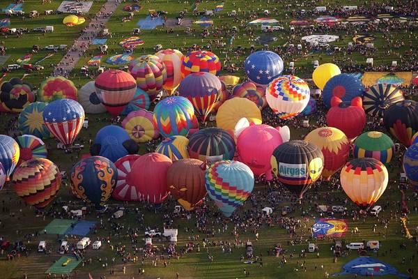 Balloon Festival Photograph - Hot Air Balloon Mass Ascent by Peter Menzel
