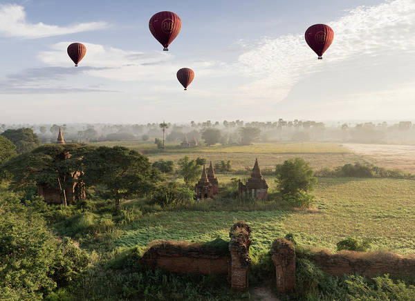 Photograph - Hot Air Balloons Flying Over Ancient by Martin Puddy