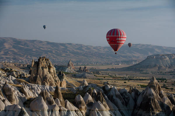 Nevsehir Photograph - Hot-air Balloons Flying Over Landscape by Tim Gerard Barker