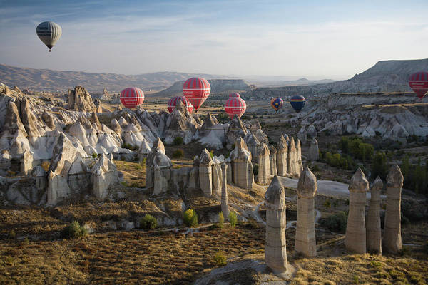 Nevsehir Photograph - Hot-air Balloons Flying Over Phallic by Tim Gerard Barker