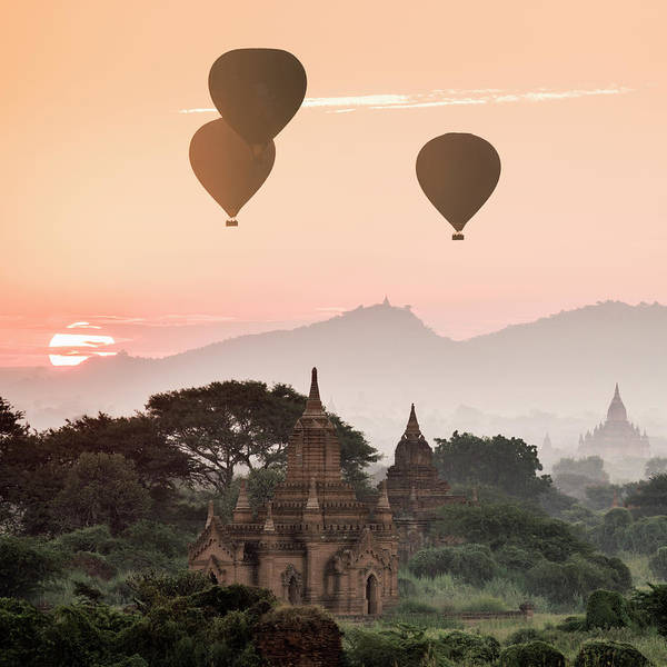 Photograph - Hot Air Balloons Flying Over Temples At by Martin Puddy